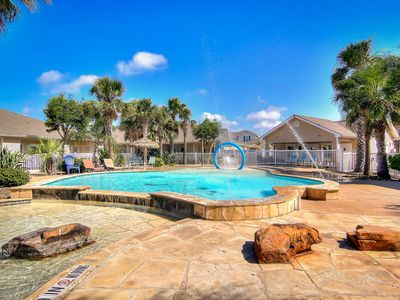 Photo for NEW LISTING! Beautiful townhouse w/shared pool, patio-short walk to beach!
