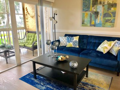 Photo for CHIC Condo Steps from the Beach equipped with all you need!