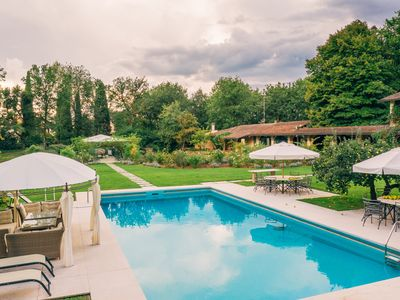 Photo for Walk to Town Villa with a big pool immersed in enchanting and blooming garden