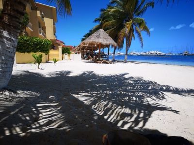 Photo for Caribbean sea is waiting for you at a discount with condo on the beach & pools