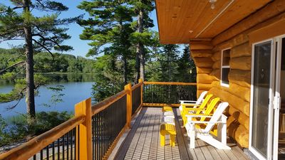 deck with wonderful lakeview and comfortable deckchairs