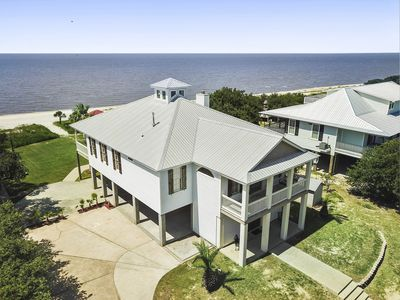 The Sandhill Beachhouse sits on almost an acre of private Gulf beach front.