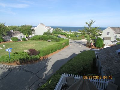 Gorgeous view from your balcony and patio. Across from grassy play area and only Steps to Beach Path.