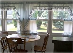 Enjoy your morning coffee in the inviting sun room just off the kitchen.