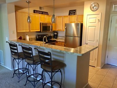 Kitchen with new granite countertops and stainless steel appliances
