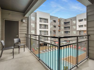 Photo for Modern condo with a shared pool, fitness room, walk to dining!