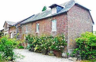 Photo for Beautifully converted detached Coach House in Normandy village