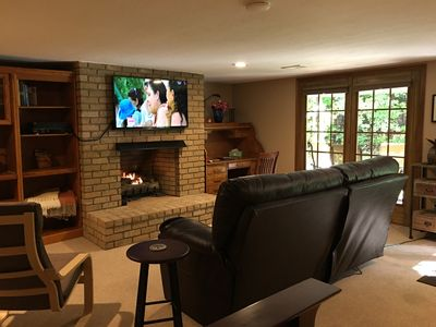 """View from the queen bed of the sitting area, gas fireplace, 52"""" Smart TV & patio"""