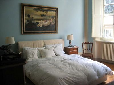 Master bedroom has a queen-size bed in a light-filled room with private bathrm