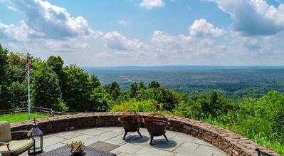 Slate patio with fire-pit provides gorgeous views.