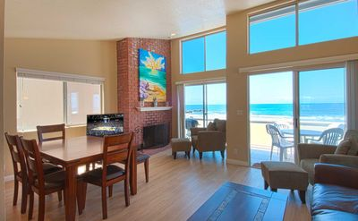 Photo for Cheery and bright upper unit is a perfect summer getaway! Just steps from beach!