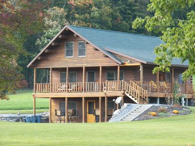 Photo for Stunning Log Home on Private Lake- Country at its best