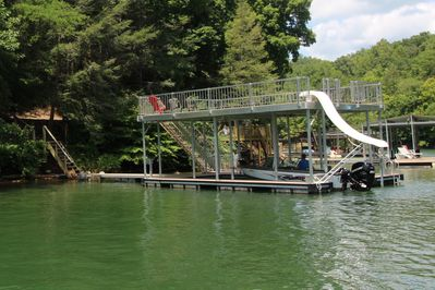 Private dock with slide, covered boat slip, room for 2 more boats.