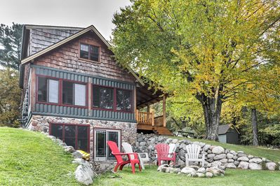 Enjoy lake views from the porch during your stay at this vacation rental cabin in Mercer!