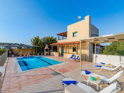 Photo for 3-bedroom villa w/ modern facade, pool and free wi-fi near the village, stunning countryside and mountain views