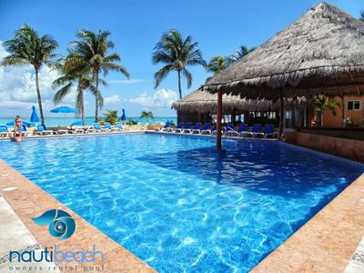 Photo for Nautibeach Condos, in Playa Norte with pool and amazing ocean view