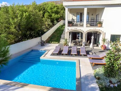 Photo for This 5-bedroom villa for up to 10 guests is located in Trogir and has a private swimming pool, air-c