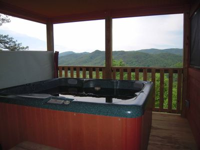 Relax in the HOT TUB which has a cover lifter for easy access and a GREAT VIEW