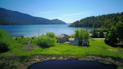 View from over the pond looking across the Outback and Cottage to Crescent Beach and Eastsound Bay