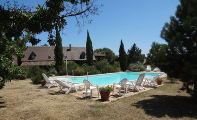 Photo for Family friendly gite near St.Cirq Lapopie with large garden & shared pool.
