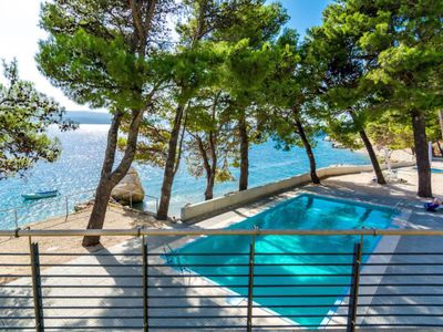 Photo for This 4-bedroom villa for up to 8 guests is located in Omis and has a private swimming pool, air-cond