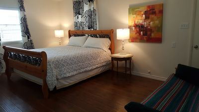 Master bedroom with a king bed and a full size futon bed