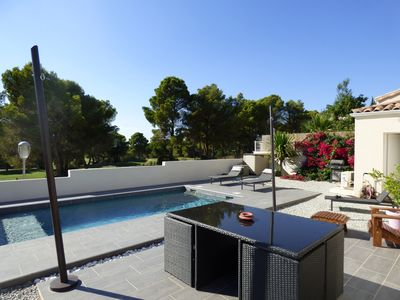 Photo for Detached villa located on the Golf du Cap d'Agde with heated pool