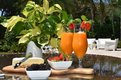 Fresh squeezed orange juice and nibbles by the pool....