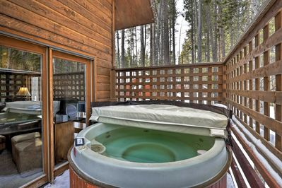 Enjoy a relaxing soak in the private hot tub!