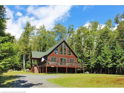 Photo for The perfect spot for a cozy getaway in the Rangeley woods