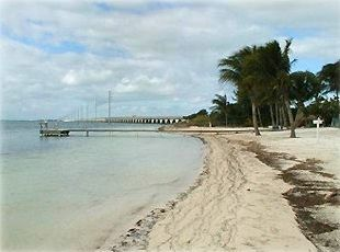 View of the beach and the dock facing the southern tip of Long Key
