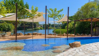 Photo for Gorgeous rental with cabins and lake views - 15 km from Cordoba
