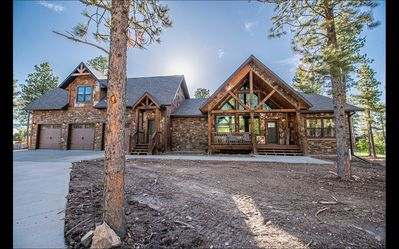Photo for Incredible 4500 sq. ft. Cabin w/ 2 Hot Tubs, 7 King Beds, 3 Car Garage!