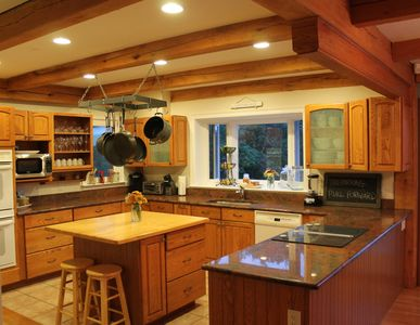 Fully equipped chef's kitchen with open floor plan to living room