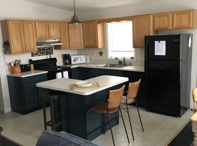 Open floor plan kitchen for cooking and gathering.