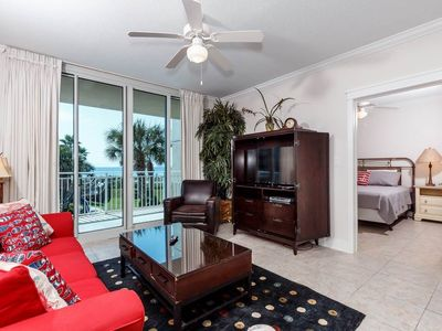 Photo for **LUXURIOUS** Beachfront Condo with 3 swimming pools!Waterfall! & Lazy river!