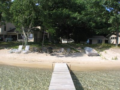 View from the dock. Check out the water clarity and beach. Walk to Glen Arbor!