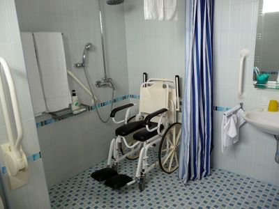 shower wheelchair commode for showering and toiletting