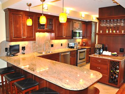 Beautiful, bright kitchen with custom premium cherry cabinets and granite tops