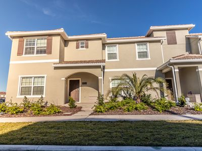 Photo for NEW 5 bedroom townhouse with pool at Storey Lake Resort near Disney