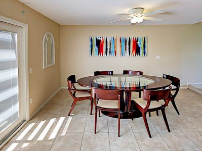 Dining Room - Enjoy meals at the contemporary dining table with seating for 6.