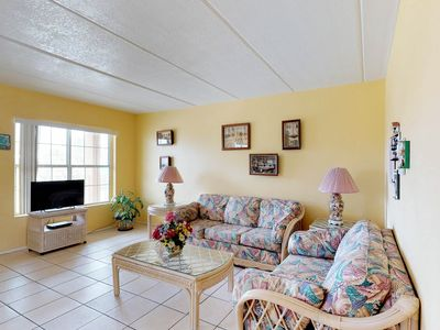 Photo for Cute, dog-friendly condo near the beach with shared pool!