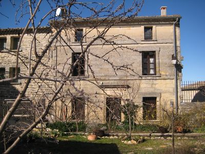 Photo for Stone village house with stunning views of  old St. Siffret, near Uzes