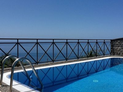 Photo for Villa with heated pool, private garden, overlooking the sea and mountain