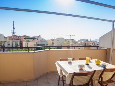 Photo for Cozy apartment with terrace overlooking the sea and the city of Alghero
