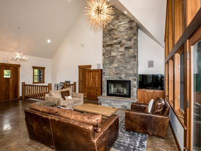 Photo for Ski-in Ski-out* right next to the chair lift!! Private hot tub and sleeps 12!