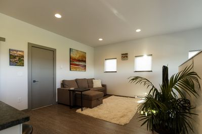 Spacious common area with comfy couch that makes into additional queen size bed.