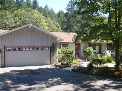 RANCH STYLE, TUSCAN DECORATED, LARGE PARKING AREA, SURROUNDED BY OAK,FIR, TREES