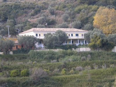 Photo for A country estate with pool surrounded by olive trees and near the sea.