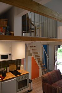 Kitchen and staircase to loft space